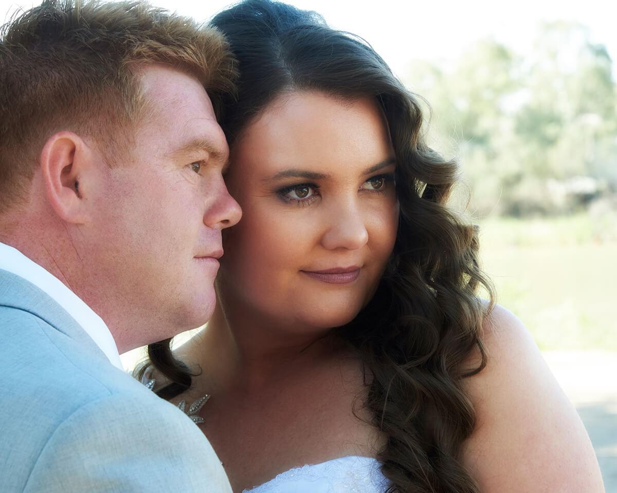 Closeup semi formal portrait of bride and groom, looking away from camera. Photo by excitations Mildura wedding photographers