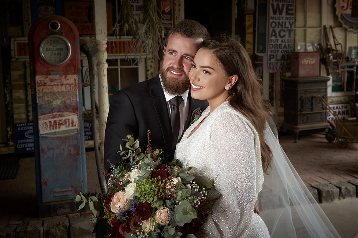 Dramatic studio lighting on bride and groom half length in old historical shed. Photo excitations, wedding photography Mildura.