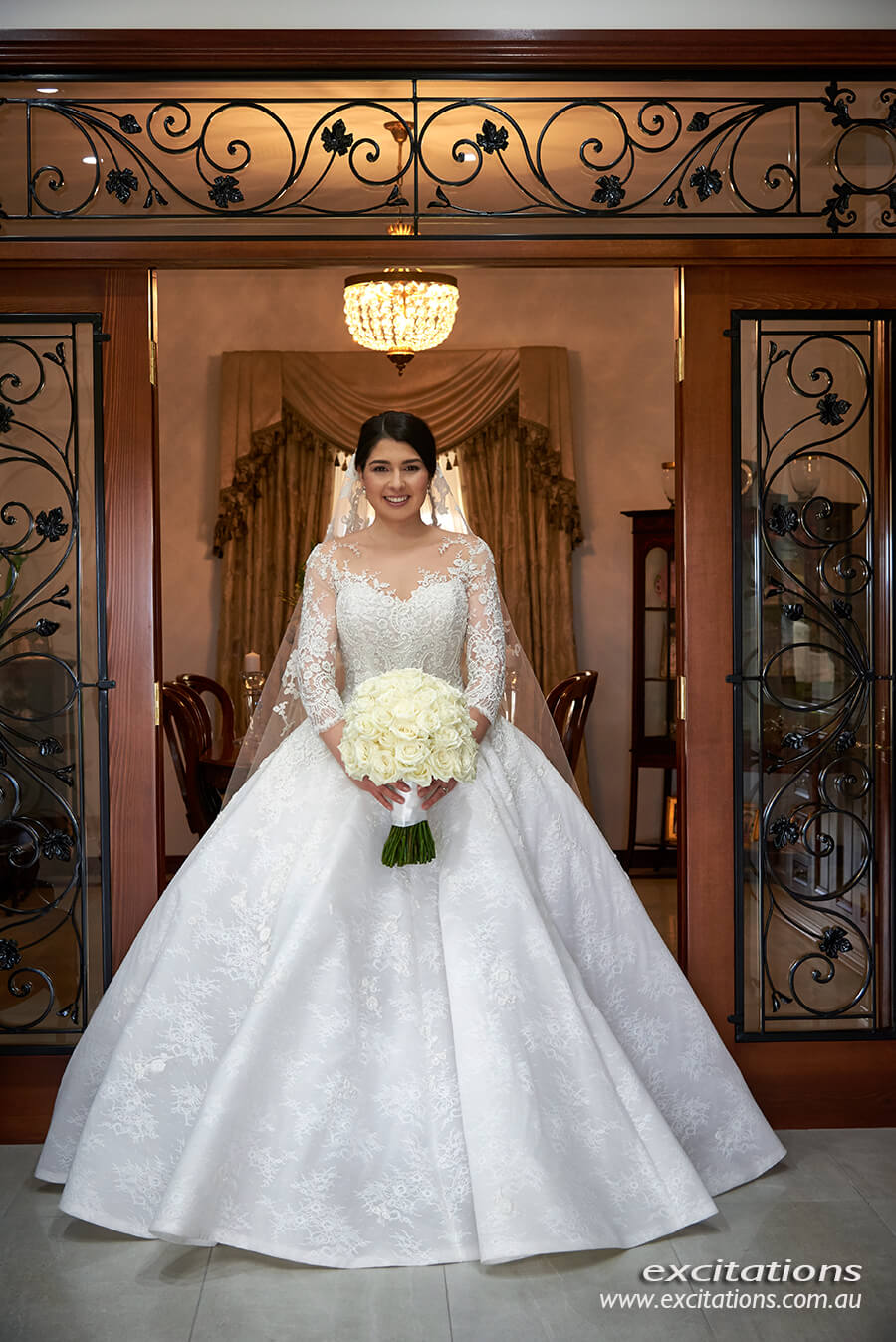 Formal full length front on photograph of a beautiful bride wearing a Steven Khalil wedding gown. Photography by Excitations, Mildura wedding photographers.
