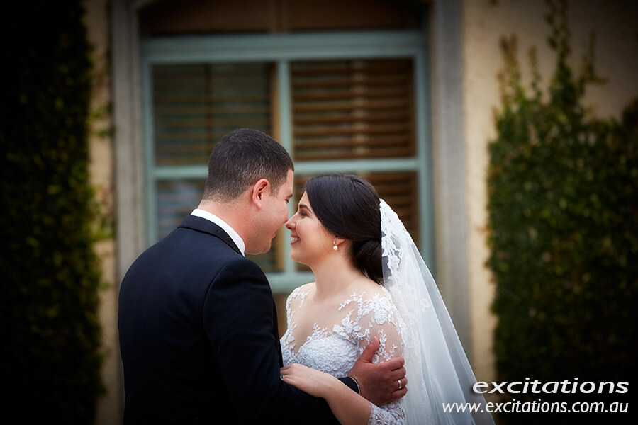Sunraysia wedding photography by excitations.Bride and groom half length casual portrait in private garden.