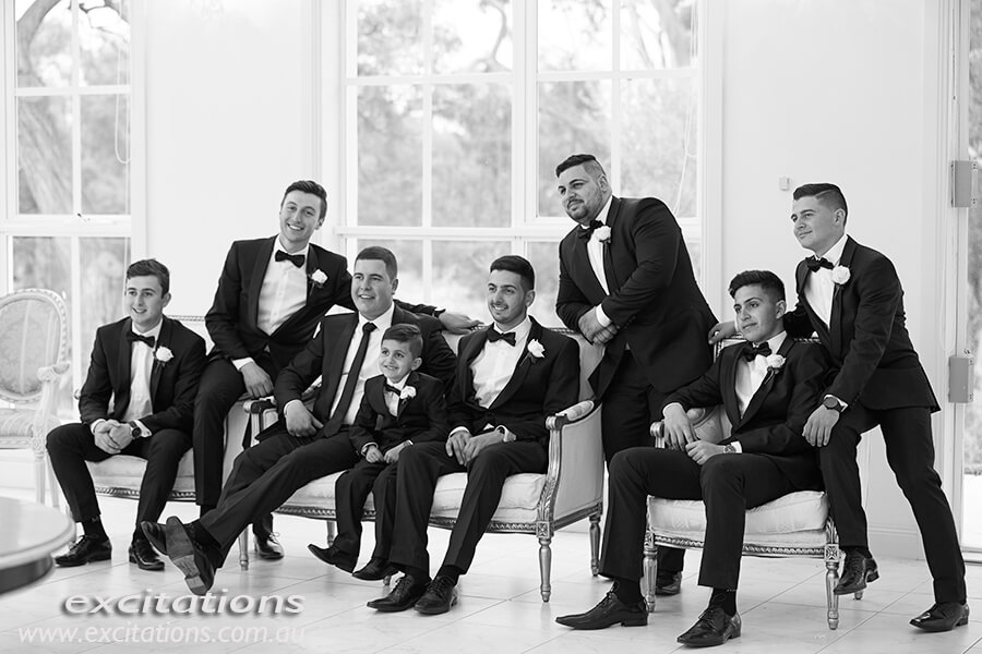 Black and white photograph of boys in bridal party having their portraits taken. Excitations, Mildura wedding photographers.