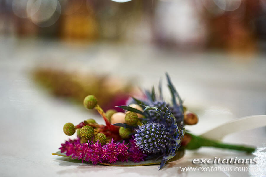 Closeup photo of mens floral button hole decorations. Married in Mildura, Excitations photography.