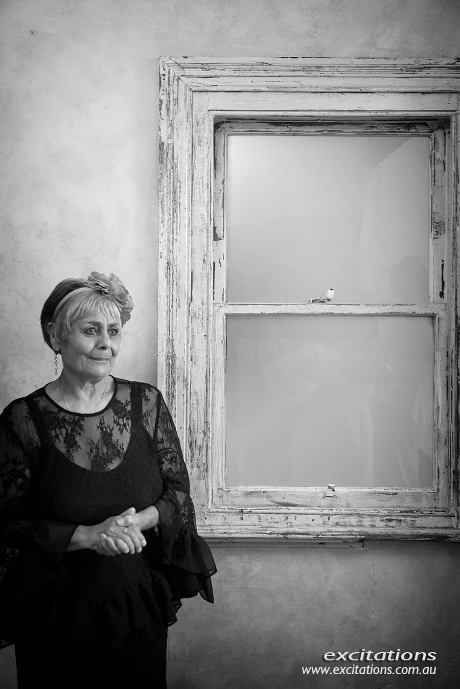 Mother of bride in candid photograph as she see her daughter in her wedding dress for the first time. Wedding photography by Excitations Mildura.
